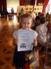 2a odbiera nagrody w Pałacu Herbsta.